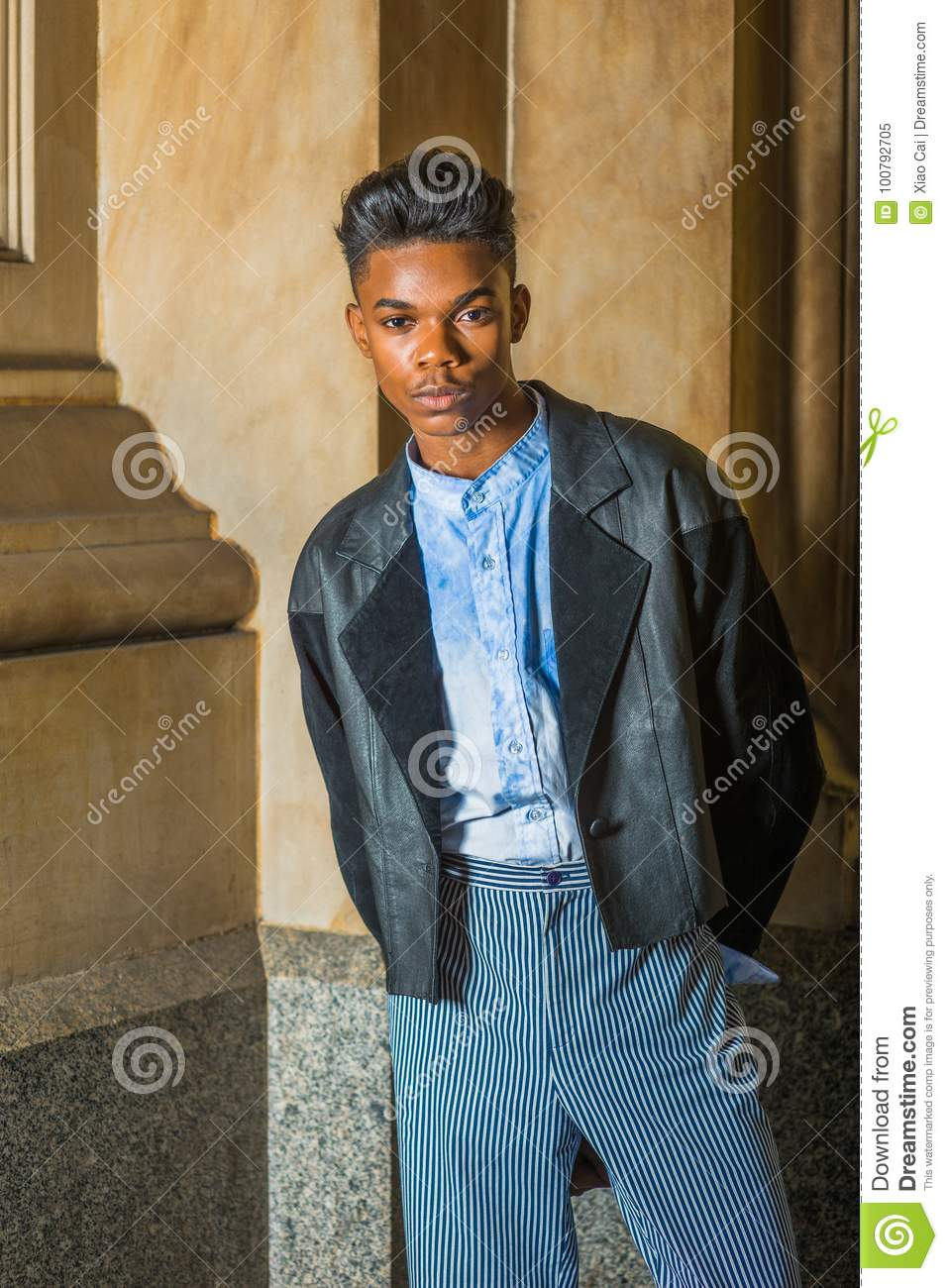 A Young18 Years Old Student Wearing Black Fashionable Leather Wool Mixed Jacket Blue Dyed White Shirted Pants Standing At The Corner