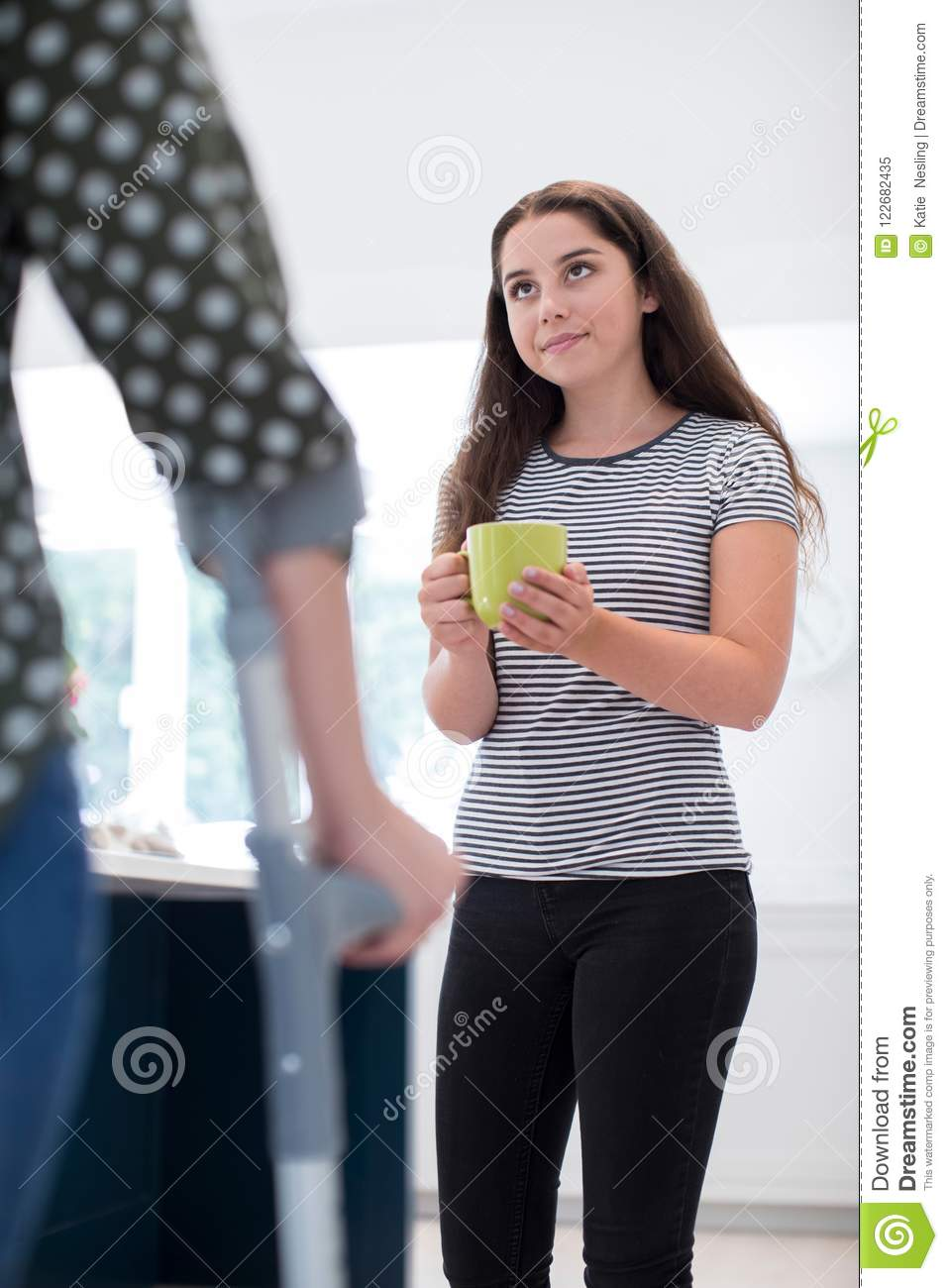 Parents Are Making Their Children Drink >> Teenage Daughter Making Drink For Disabled Parent Stock Image