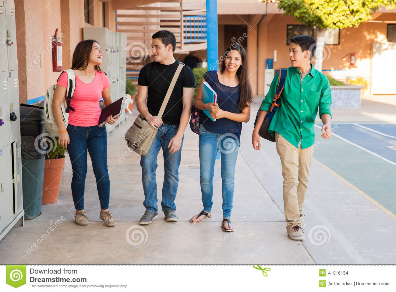 Teenage Friends In A Hallway Stock Photo - Image of books ...