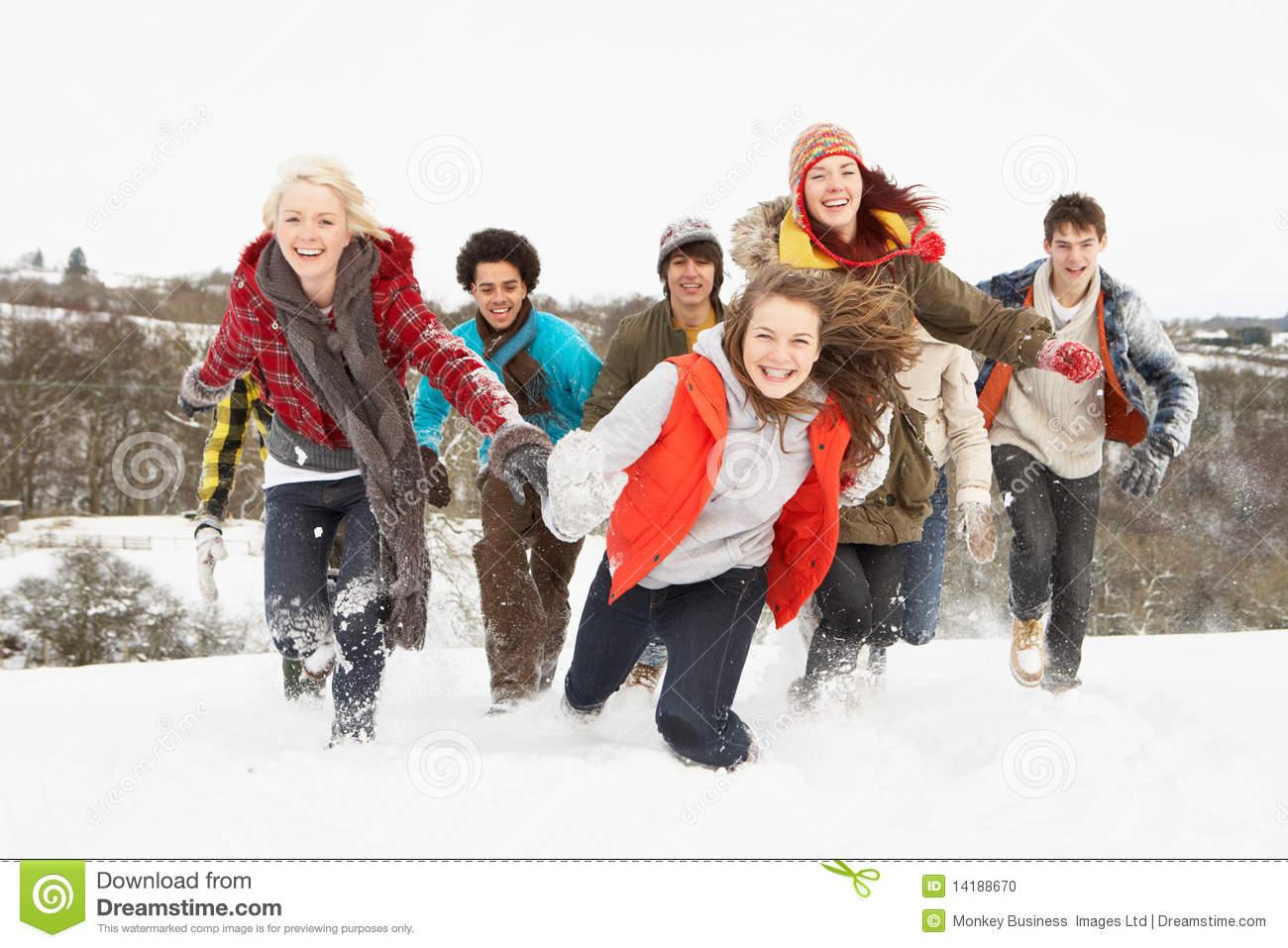 Teenage Friends Having Fun In Snowy Landscape