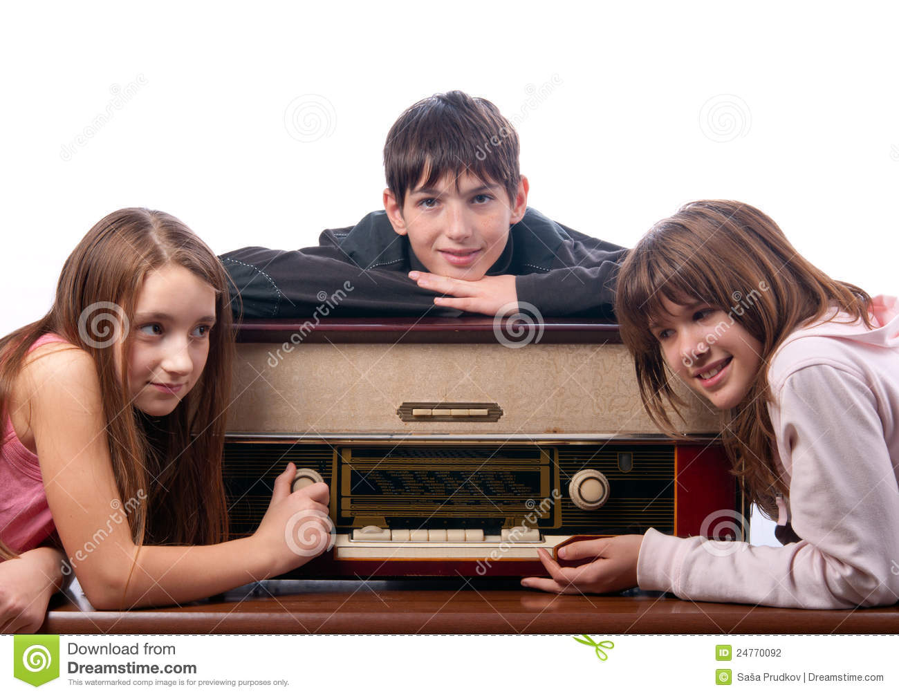 Teenage Friends Listening To Music On Old Radio Stock ...
