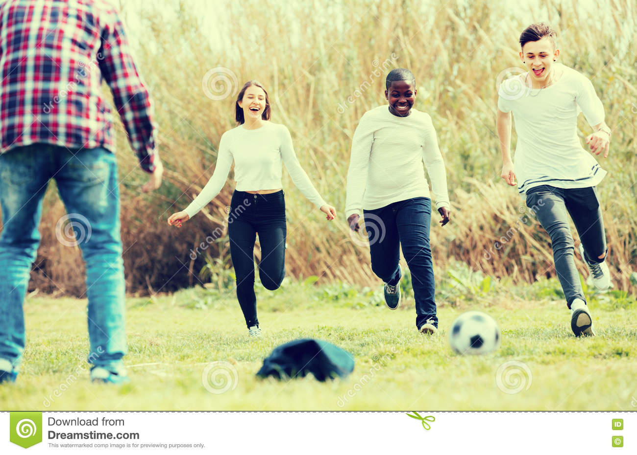 Teenage Friends Playing Football Stock Photo - Image: 71619919