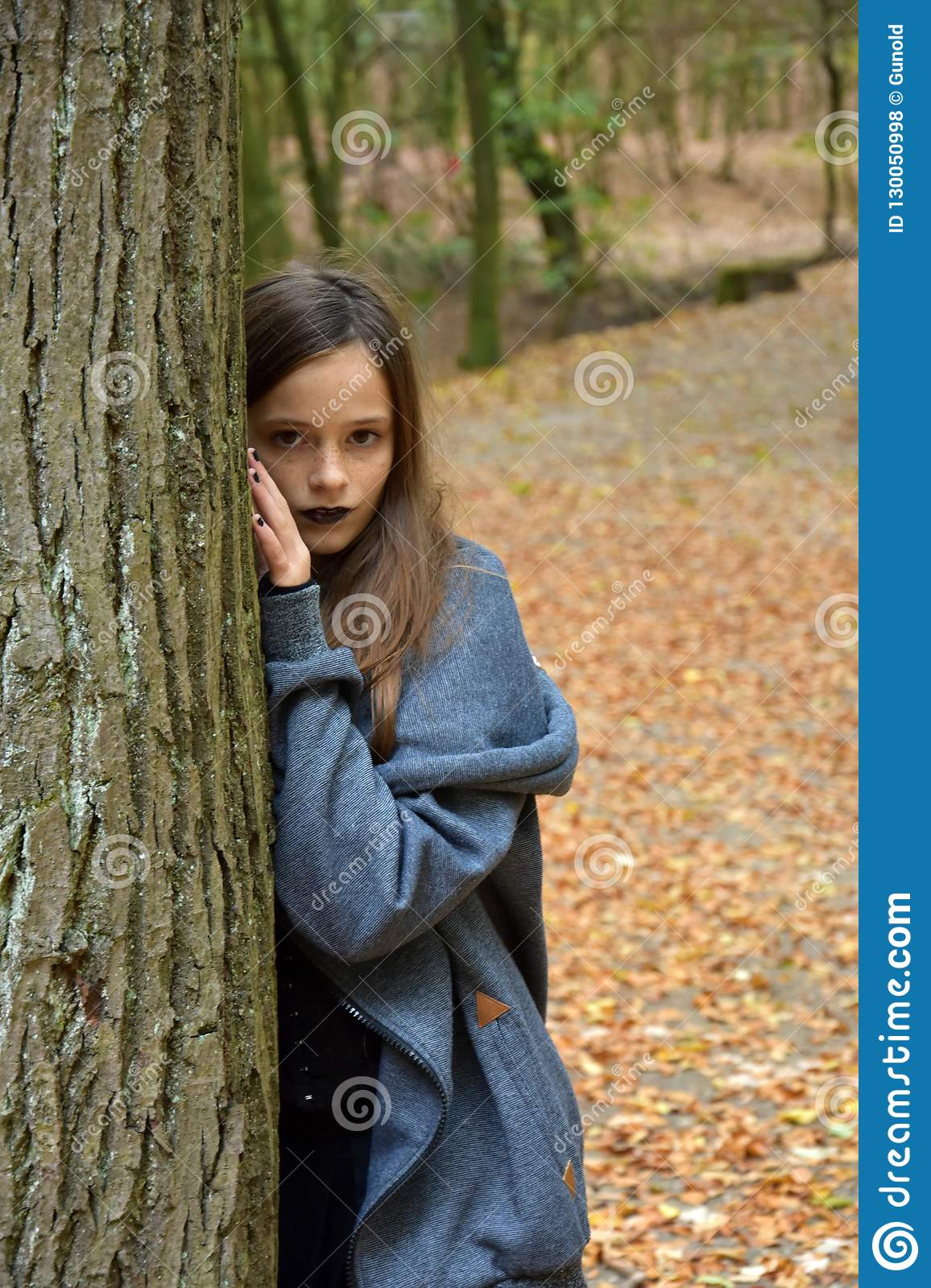 Teenage girl in autumn forest