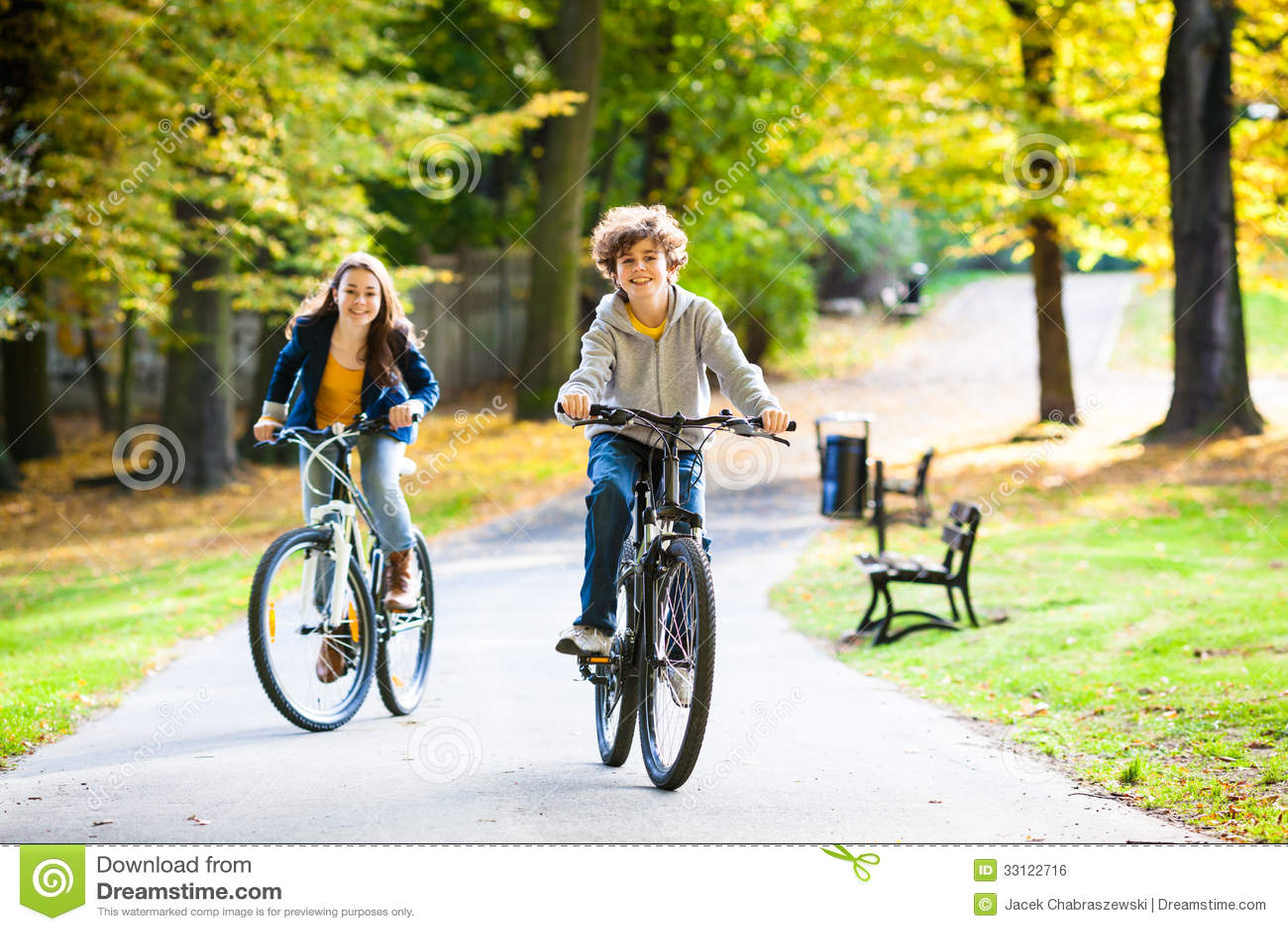 Teenage Girl And Boy Biking Royalty Free Stock Image ...