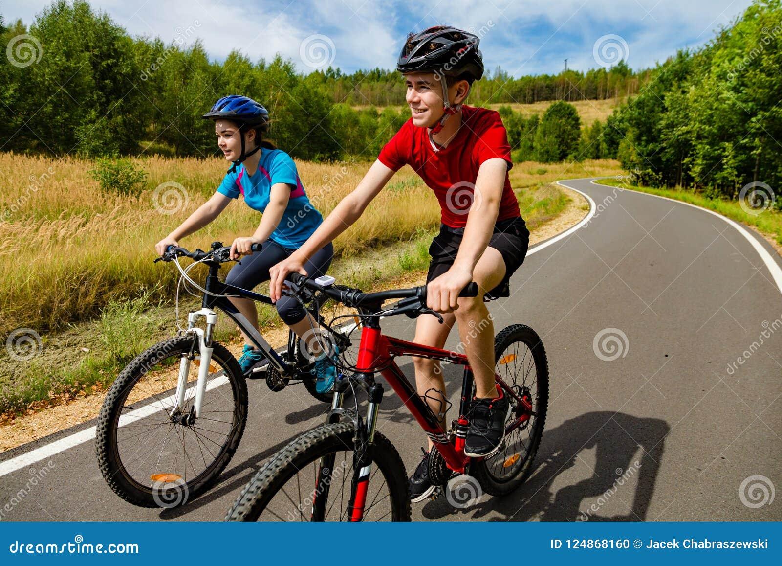Teenage girl and boy cycling