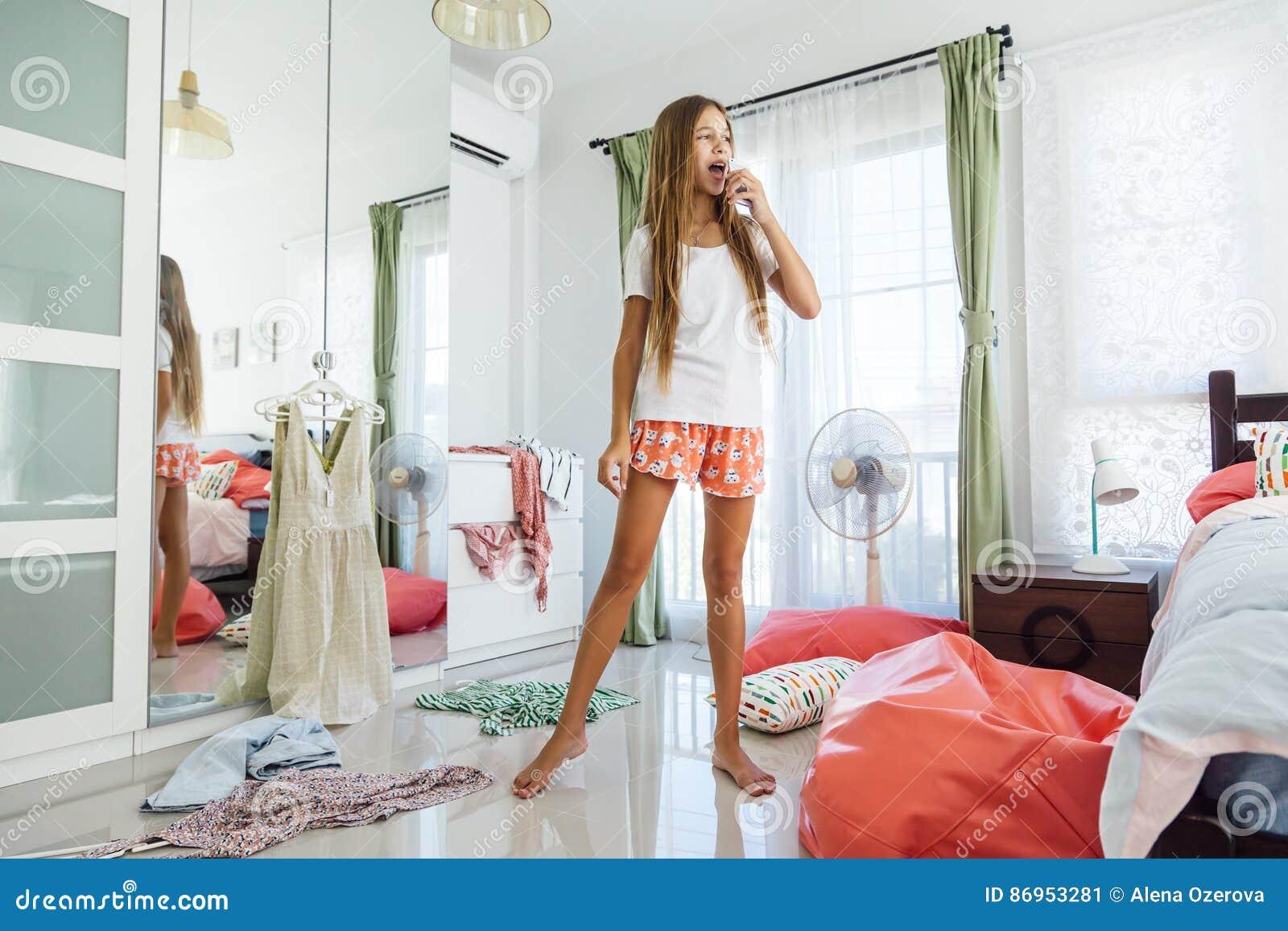 Bon Teenage Girl Choosing Clothing In Closet