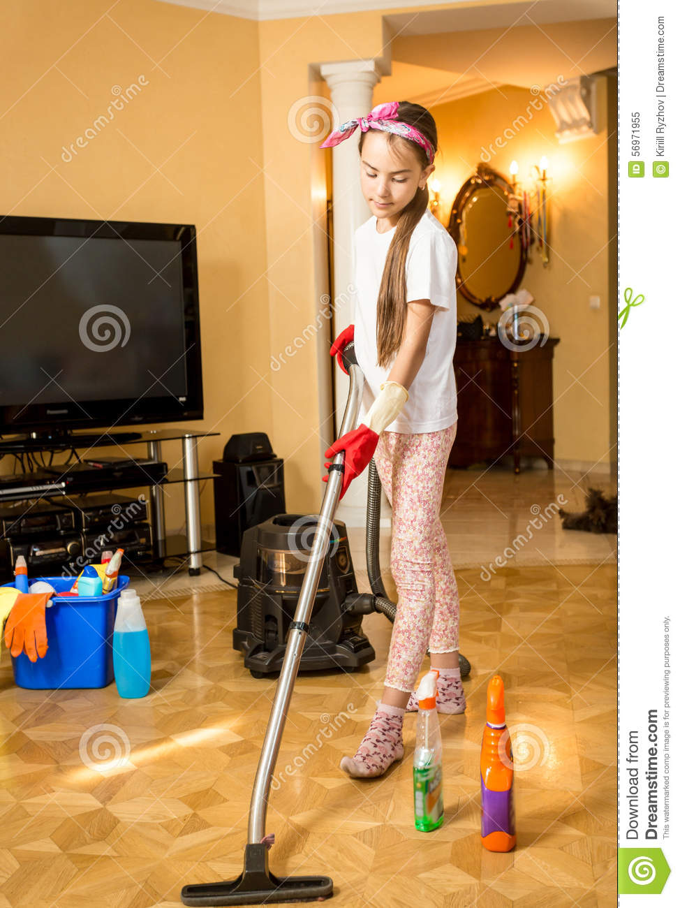 Teenage Girl Cleaning Floor At Living Room With Vacuum