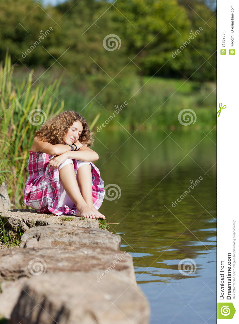LustyGuide for Girl sitting on rock into
