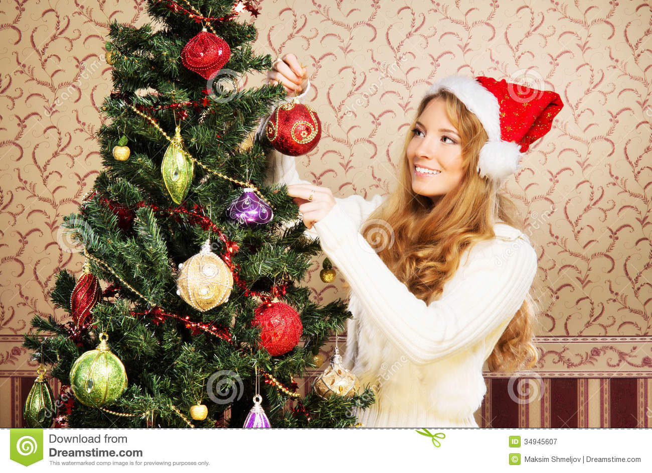 A Teenage Girl Decorating The Christmas Tree Royalty Free