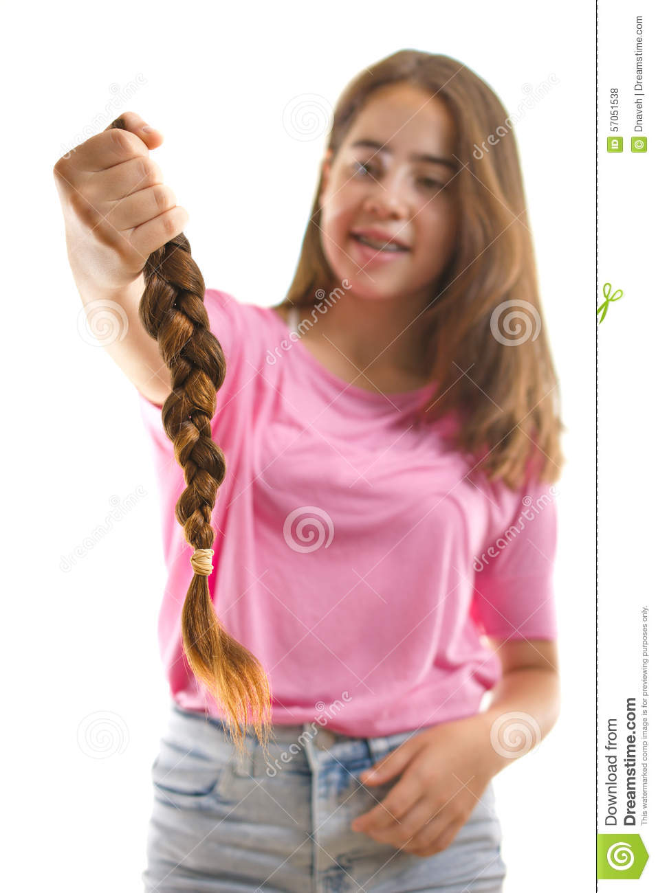 Teenage Girl Donating Her Hair To Cancer Patients Stock Photo