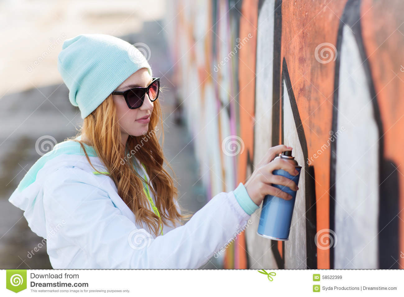 Teenage girl drawing graffiti with spray paint stock photo for Happy color spray paint price