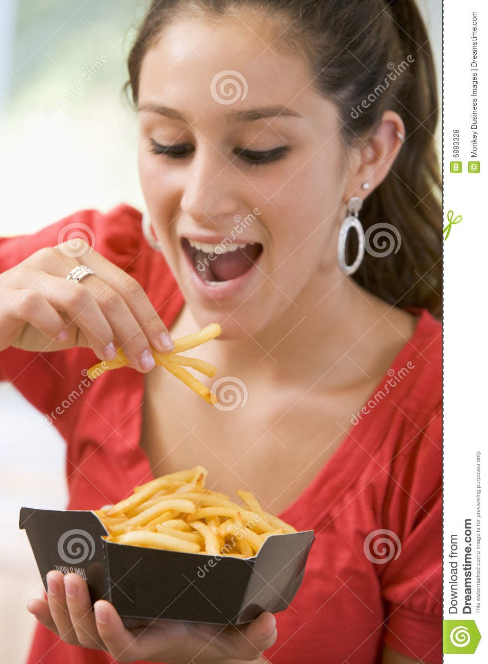 Teenage Girl Eating French Fries Royalty Free Stock Photos ...