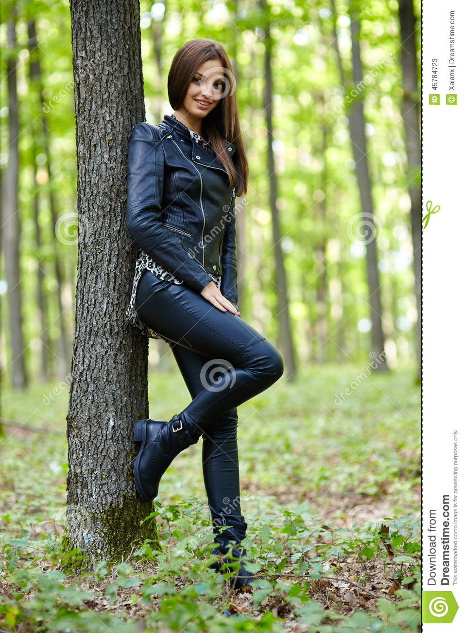 A Girl Leaning Against A Tree. Stock Photo - Image of
