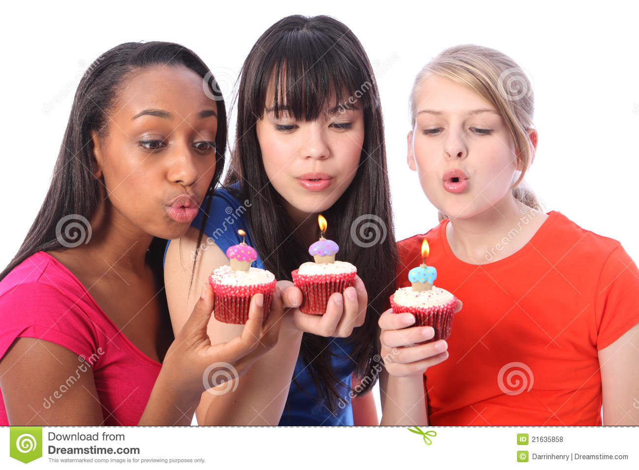 Teenage Girl Friends Blowing Out Birthday Candles Royalty