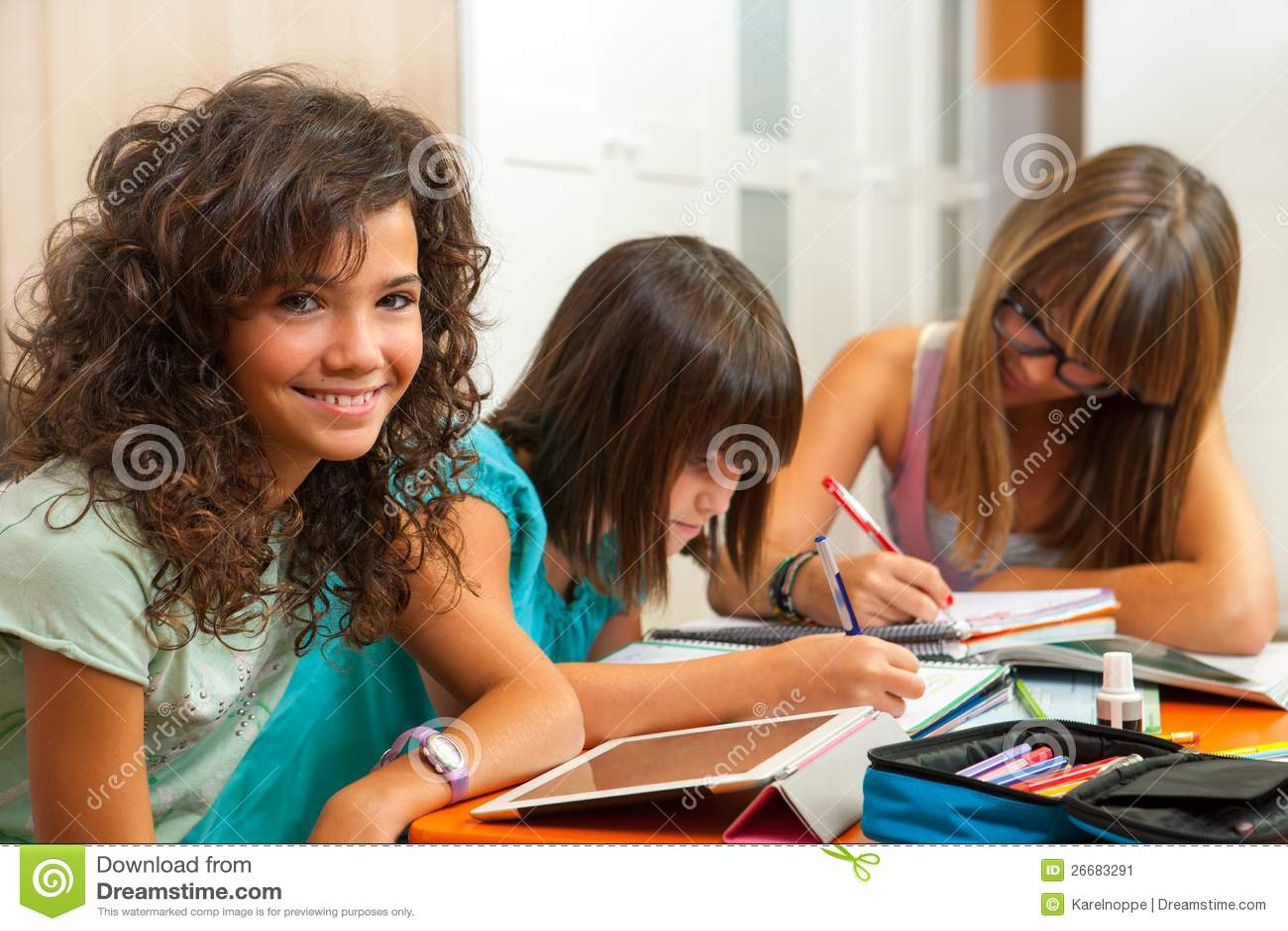 Teenage Girl With Friends Doing Homework Stock Image