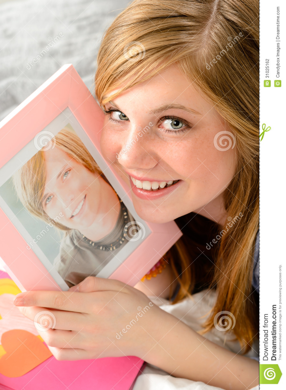 Teenage girl holding picture of her love stock photography for Teen age girl picthar