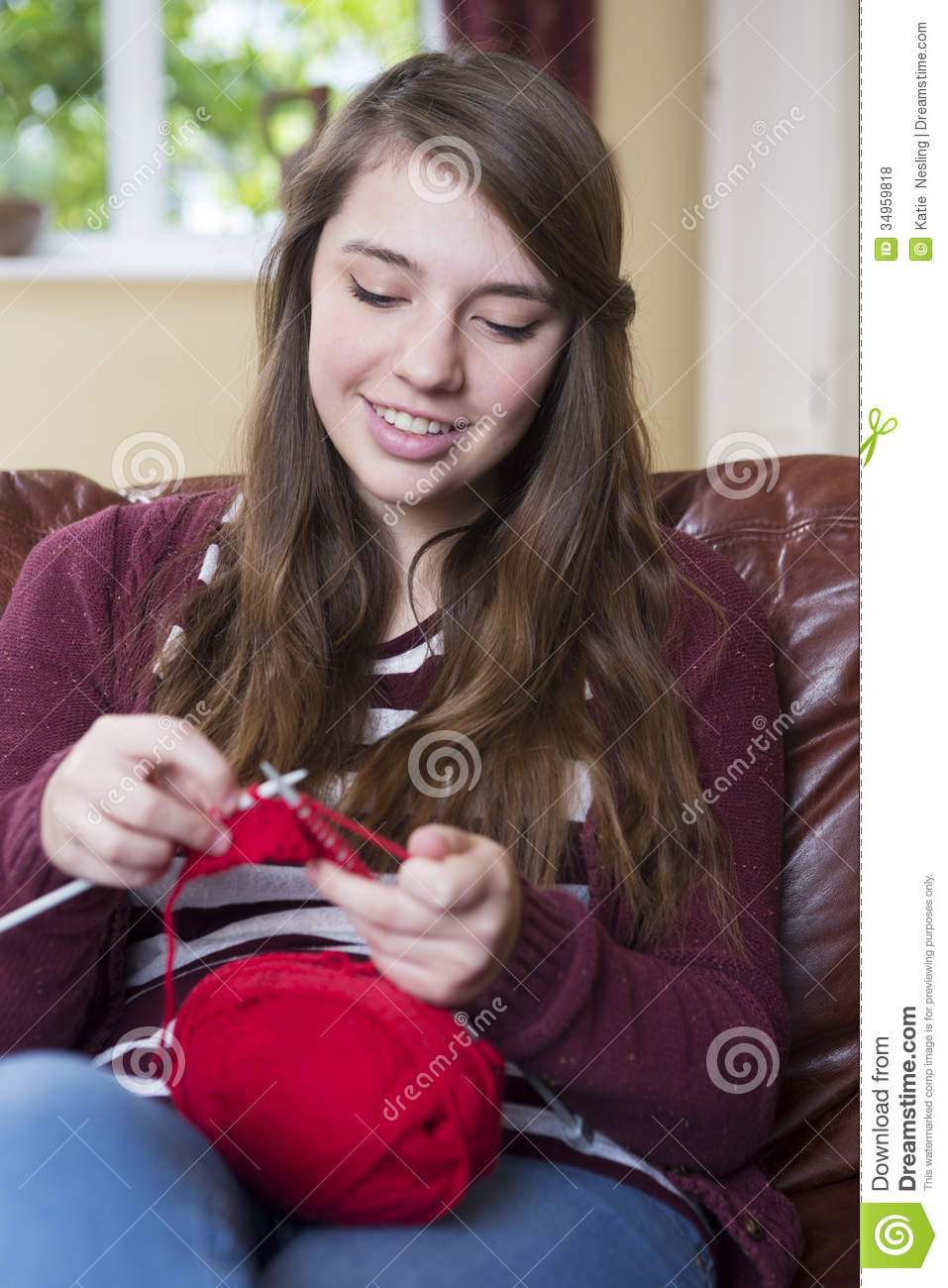 teenage girl knitting at home stock photo image of smiling thread 34959818. Black Bedroom Furniture Sets. Home Design Ideas