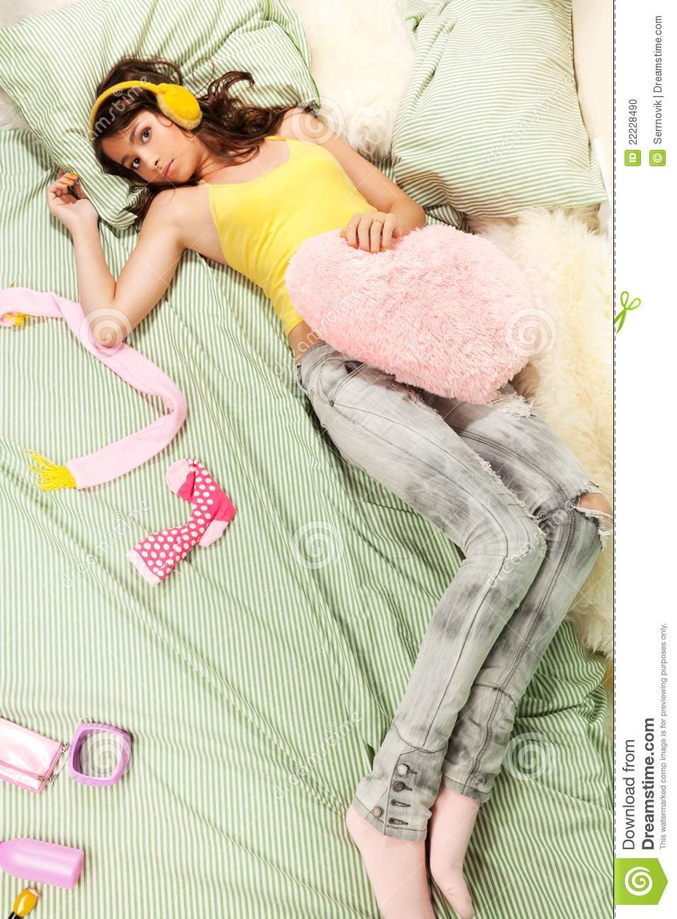 teenage girl laying in her bed stock photo image 22228490. Black Bedroom Furniture Sets. Home Design Ideas