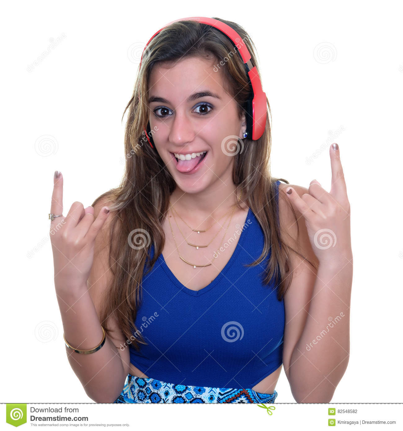 Teenage girl listening to music on wireless headphones isolated