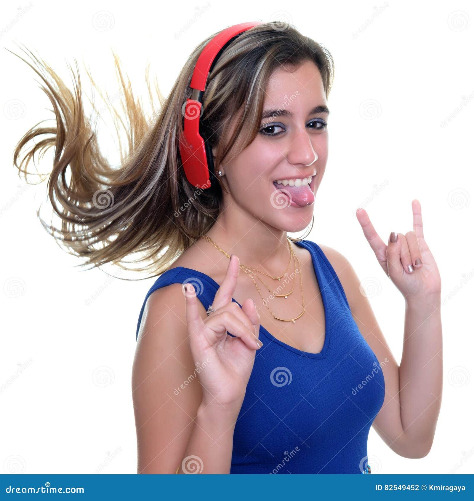 Teenage girl listening to music on wireless headphones isolated
