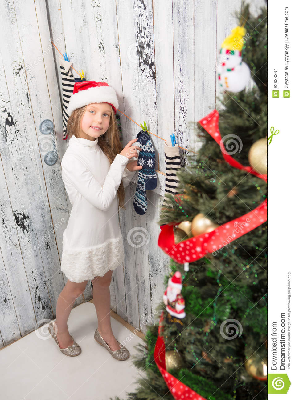 Teenage Girl Looking Into New Year And Christmas Socks ...
