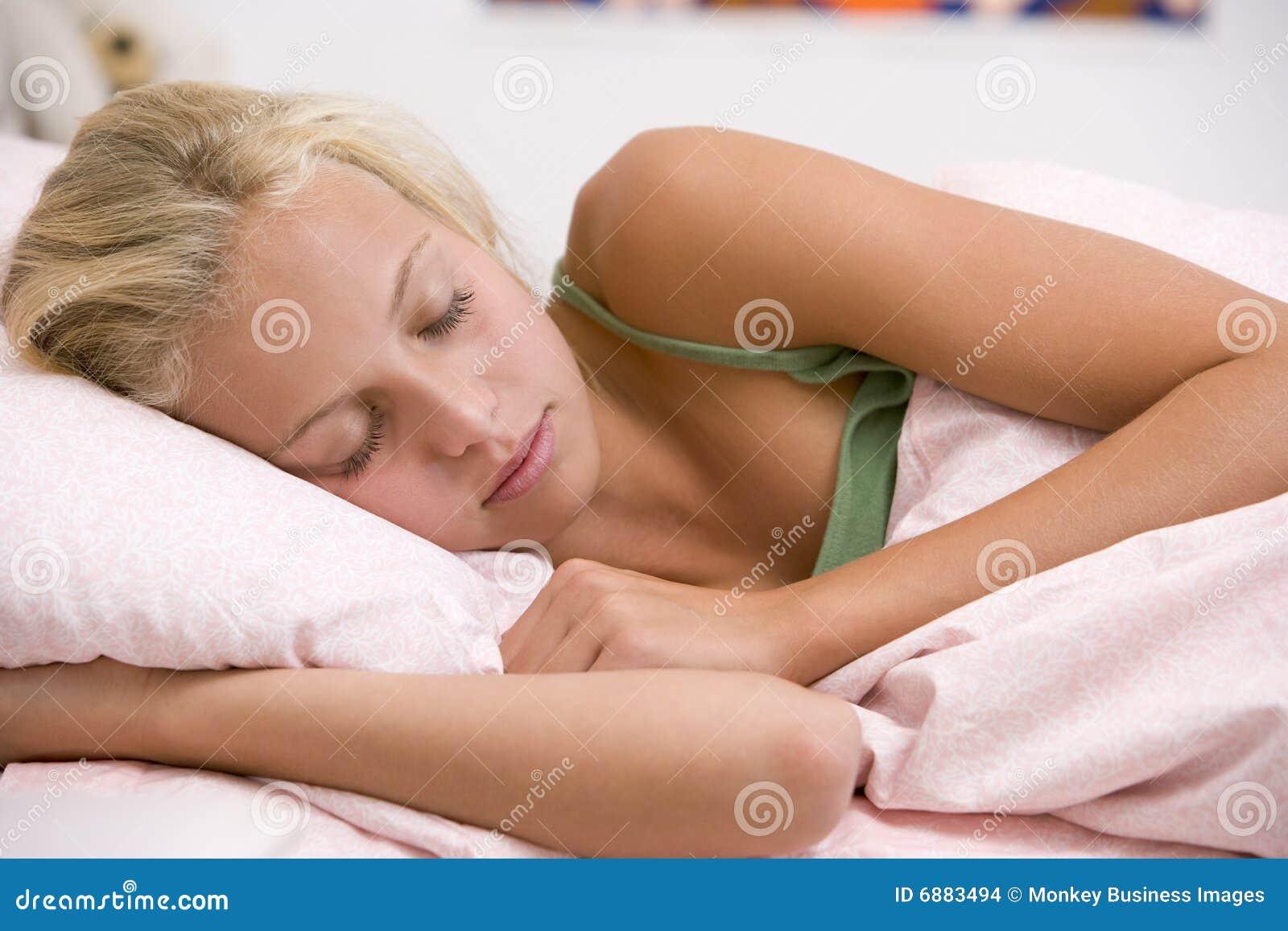 Teenage Girl Lying On Her Bed