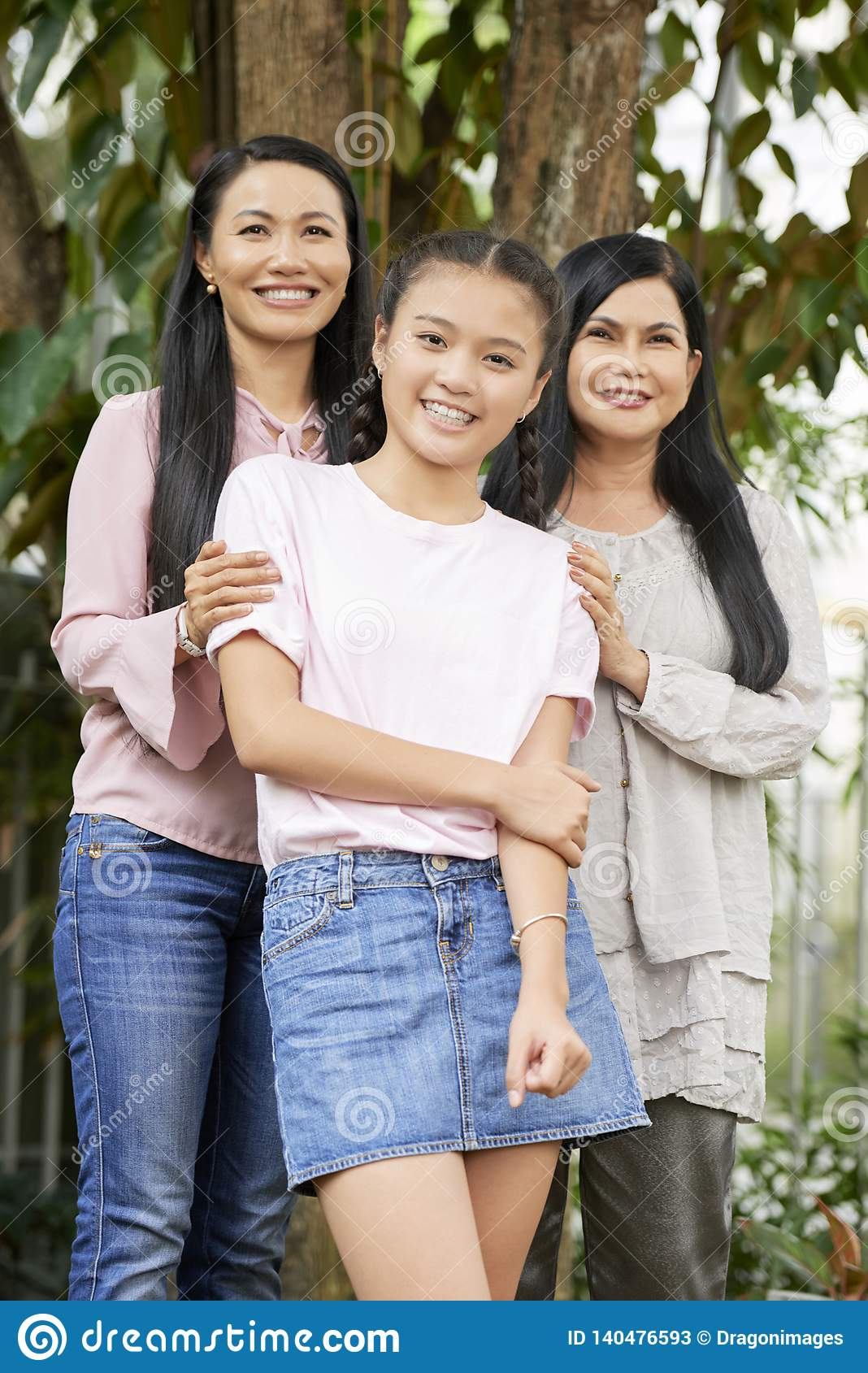 Teenage girl with mother and grandmother