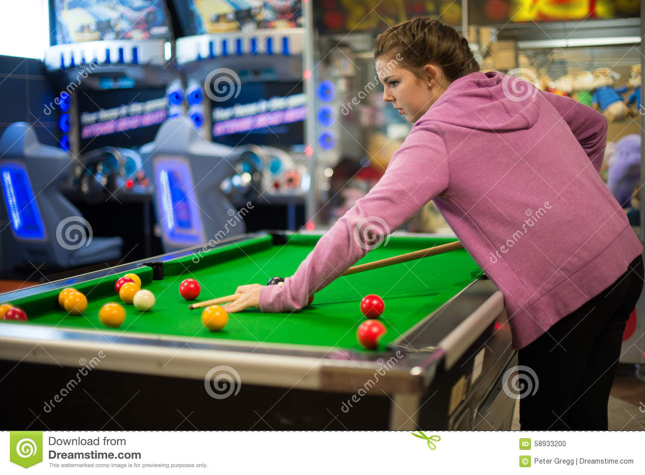 Teenage girl playing pool