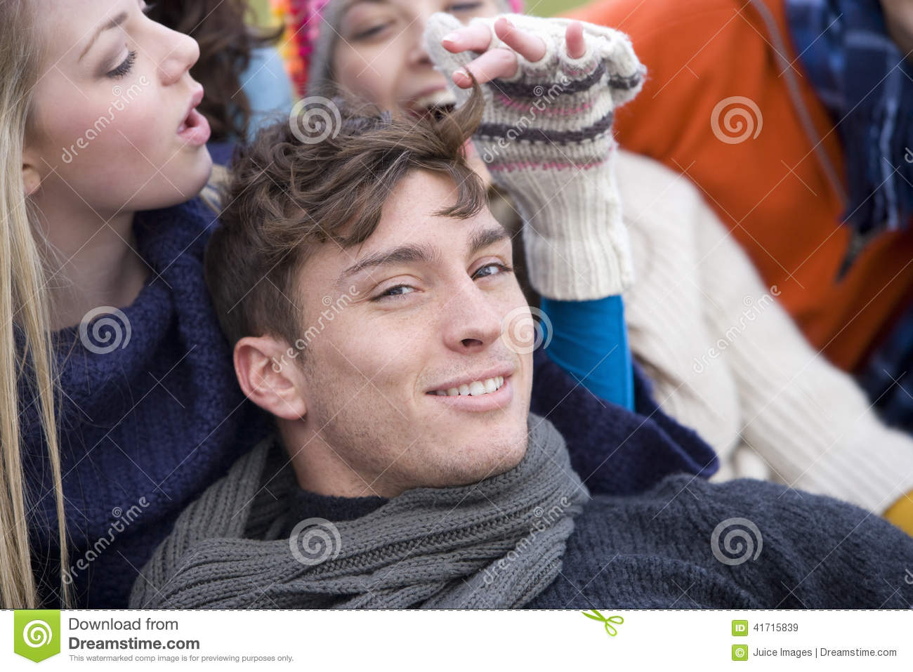 Teenage girl playing with young man s hair
