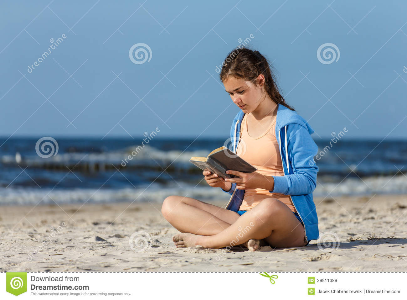 Nude beach girl with man reading book for that