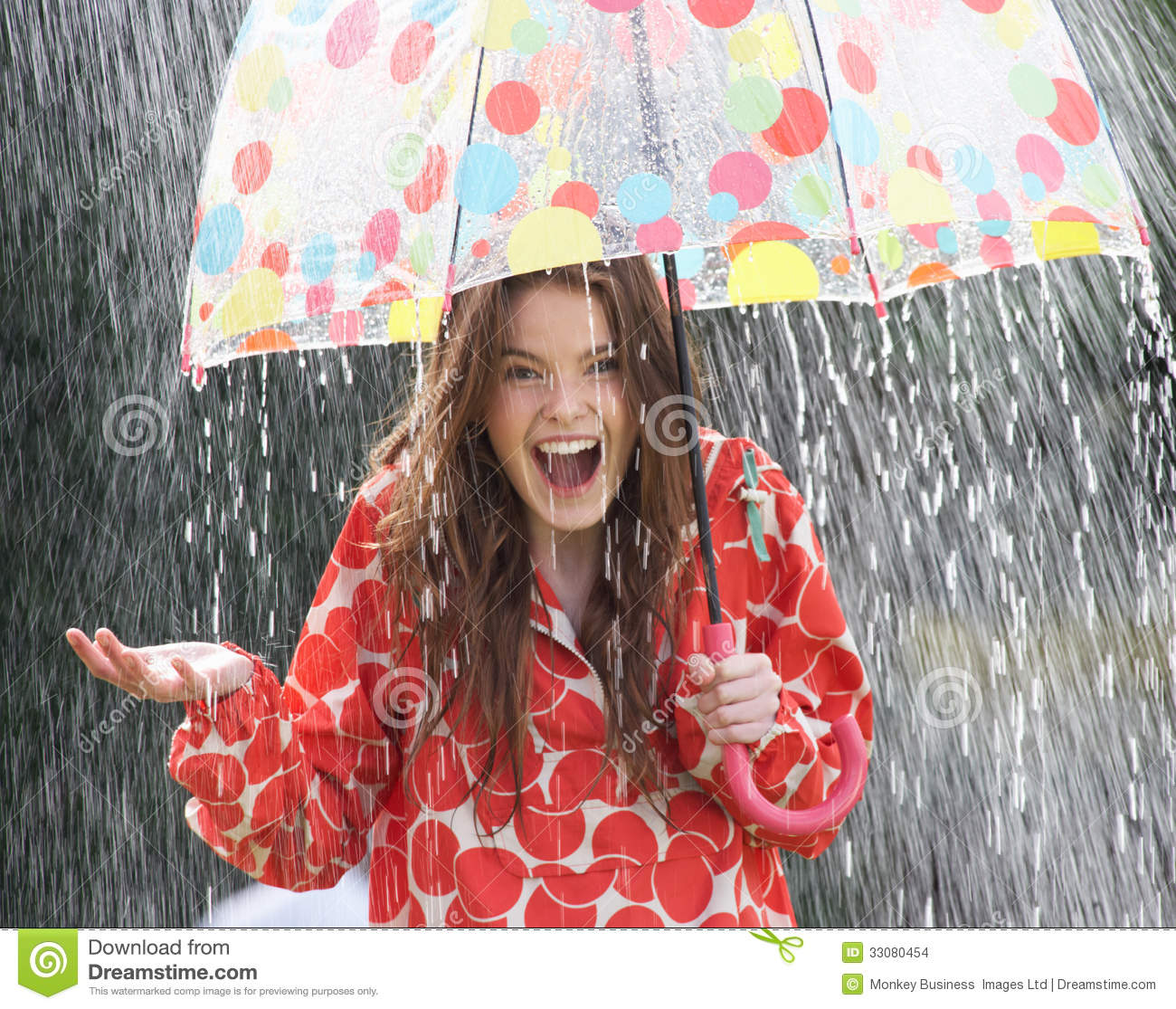 Teenage Girl Sheltering From Rain Beneath Umbrella Stock ...