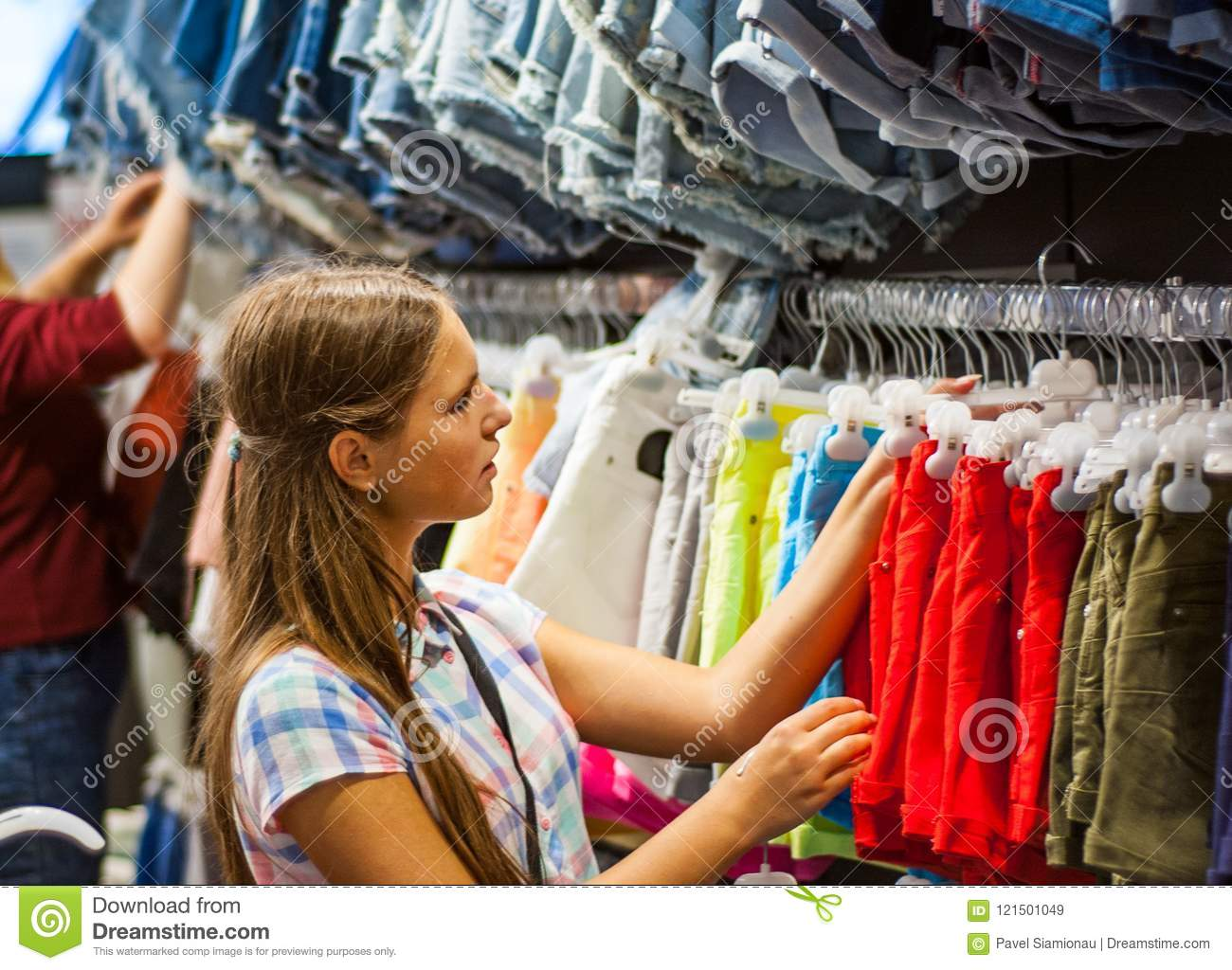 df15f19d9 Teenage Girl Shopping For Clothes Inside Clothing Store Stock Image ...