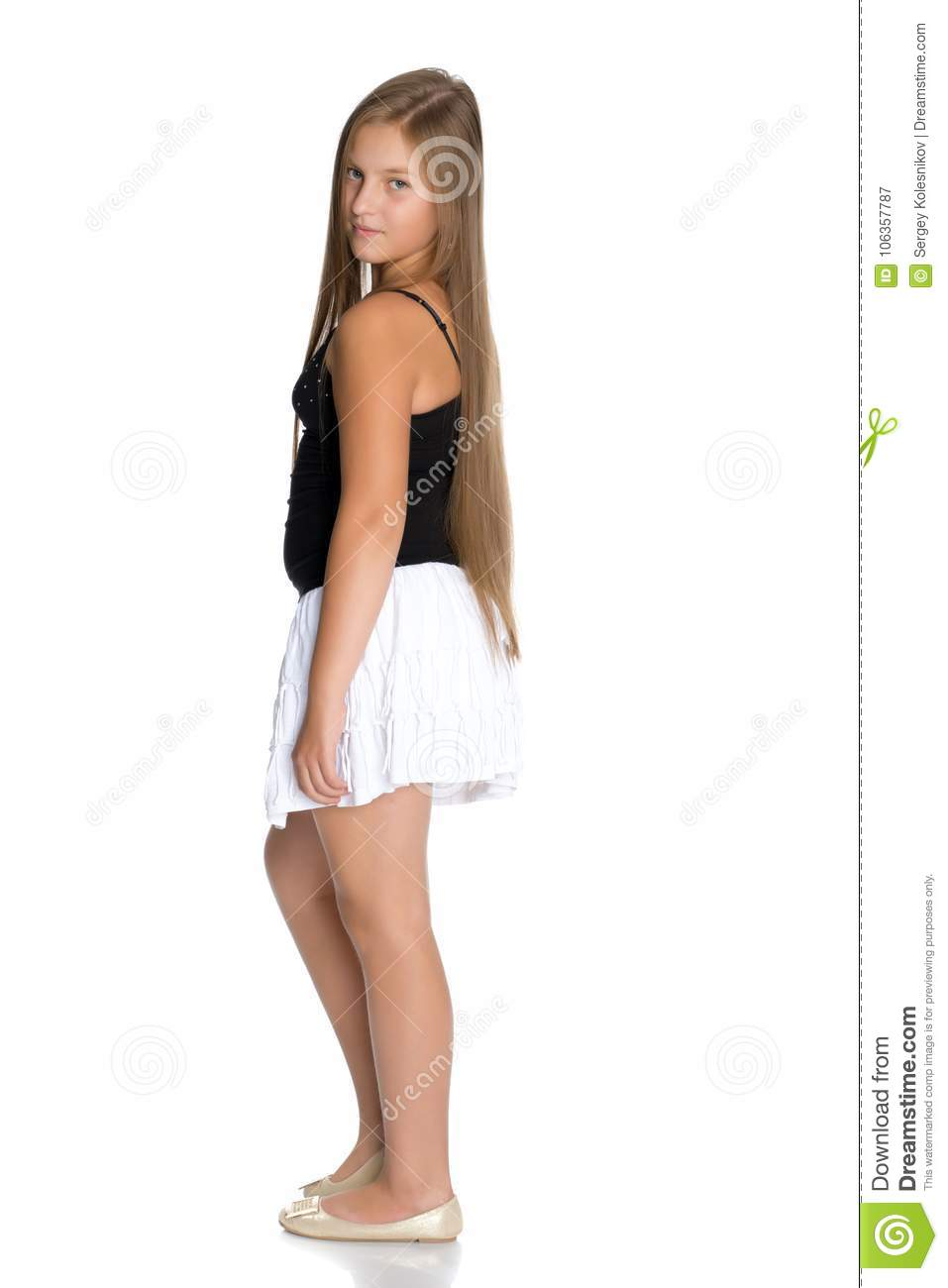 9f4f0618dd A teenage girl in a short white skirt and a black T-shirt. Royalty-Free  Stock Photo
