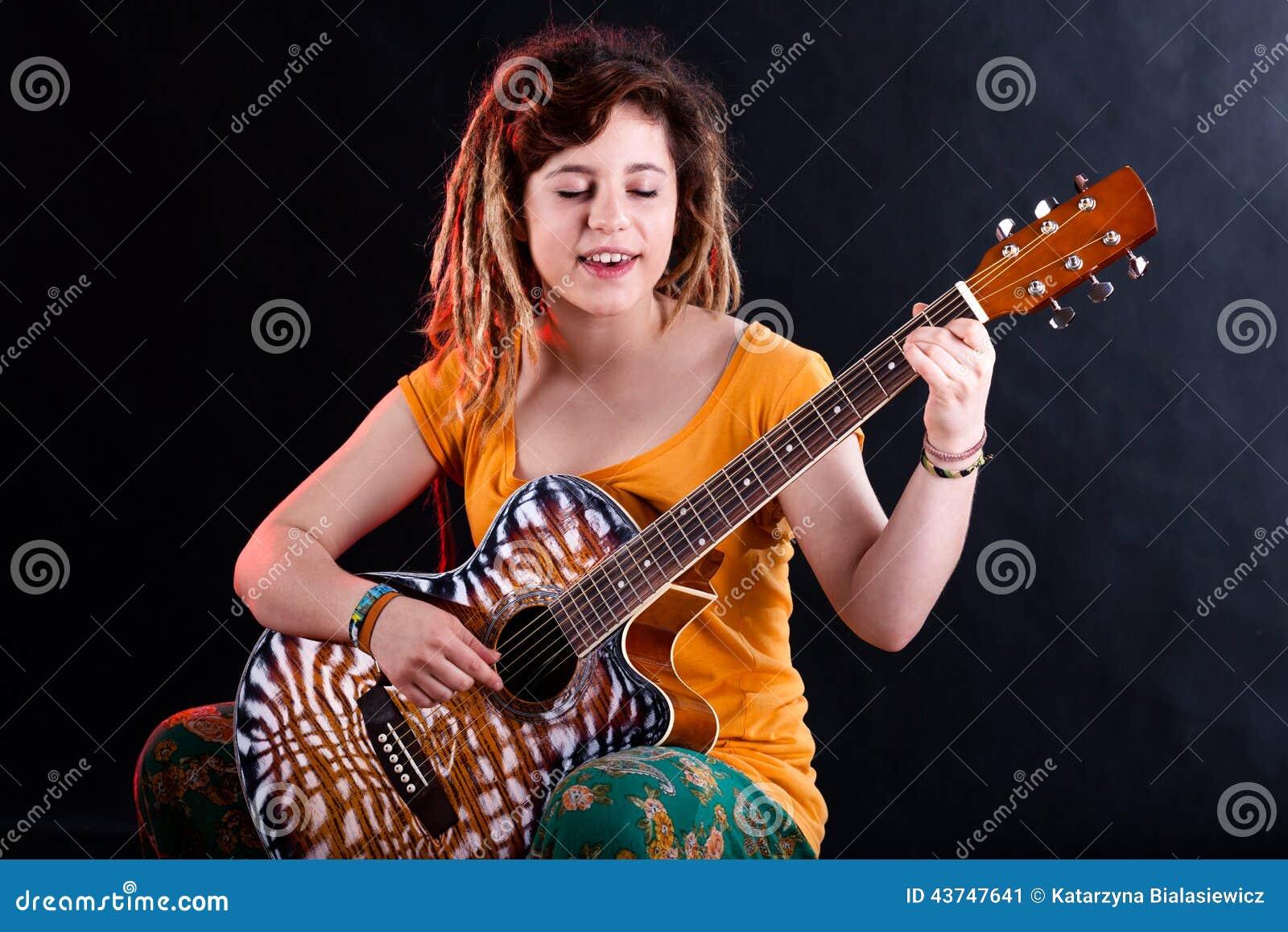 Teenage Girl Singing And Playing Guitar Stock Image - Image Of Instrument, Black 43747641-8527