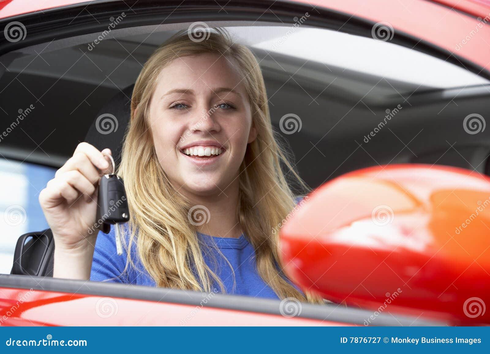 Teenage Girl Sitting In Car, Holding Car Keys