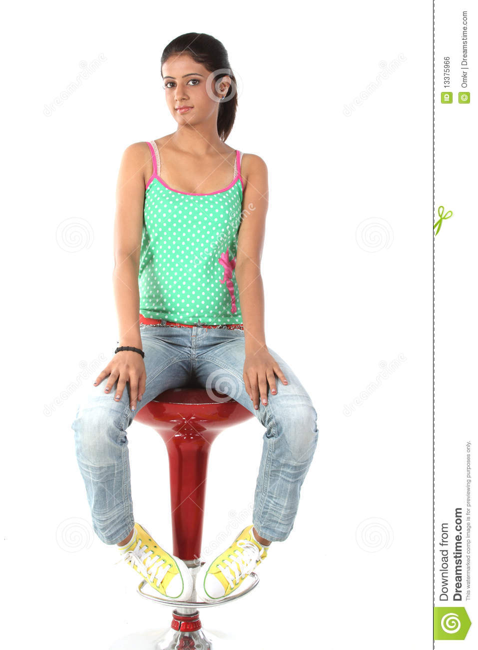 Are also teen girl sitting on chair