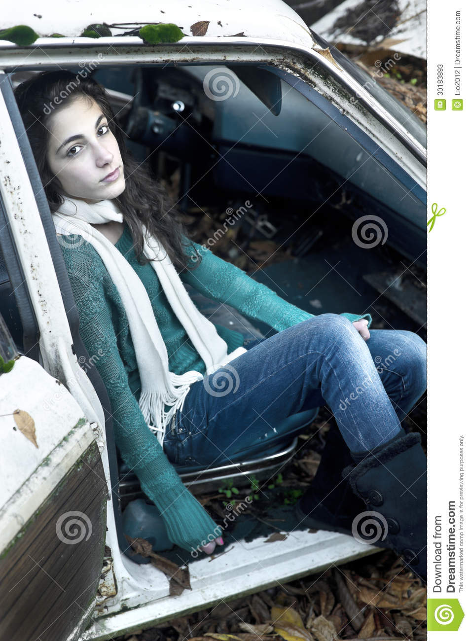 Teenage Girl Sitting In A Car