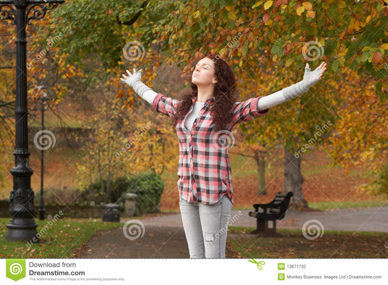 Teenage Girl Standing In Autumn Park Stock Photo Image