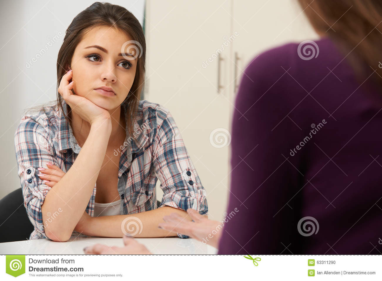 Teenage Girl Suffering From Depression Visiting Counsellor