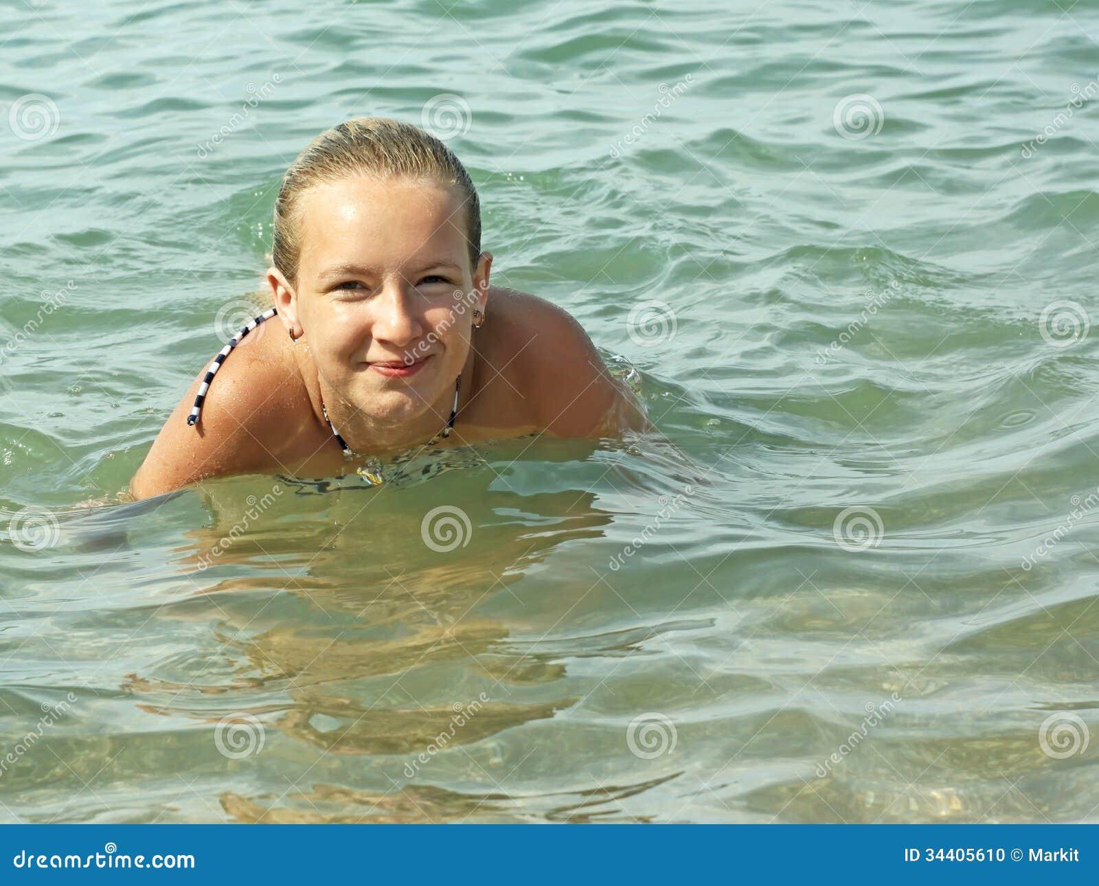 teenage girl swimming in seawater stock photo - image of bottom