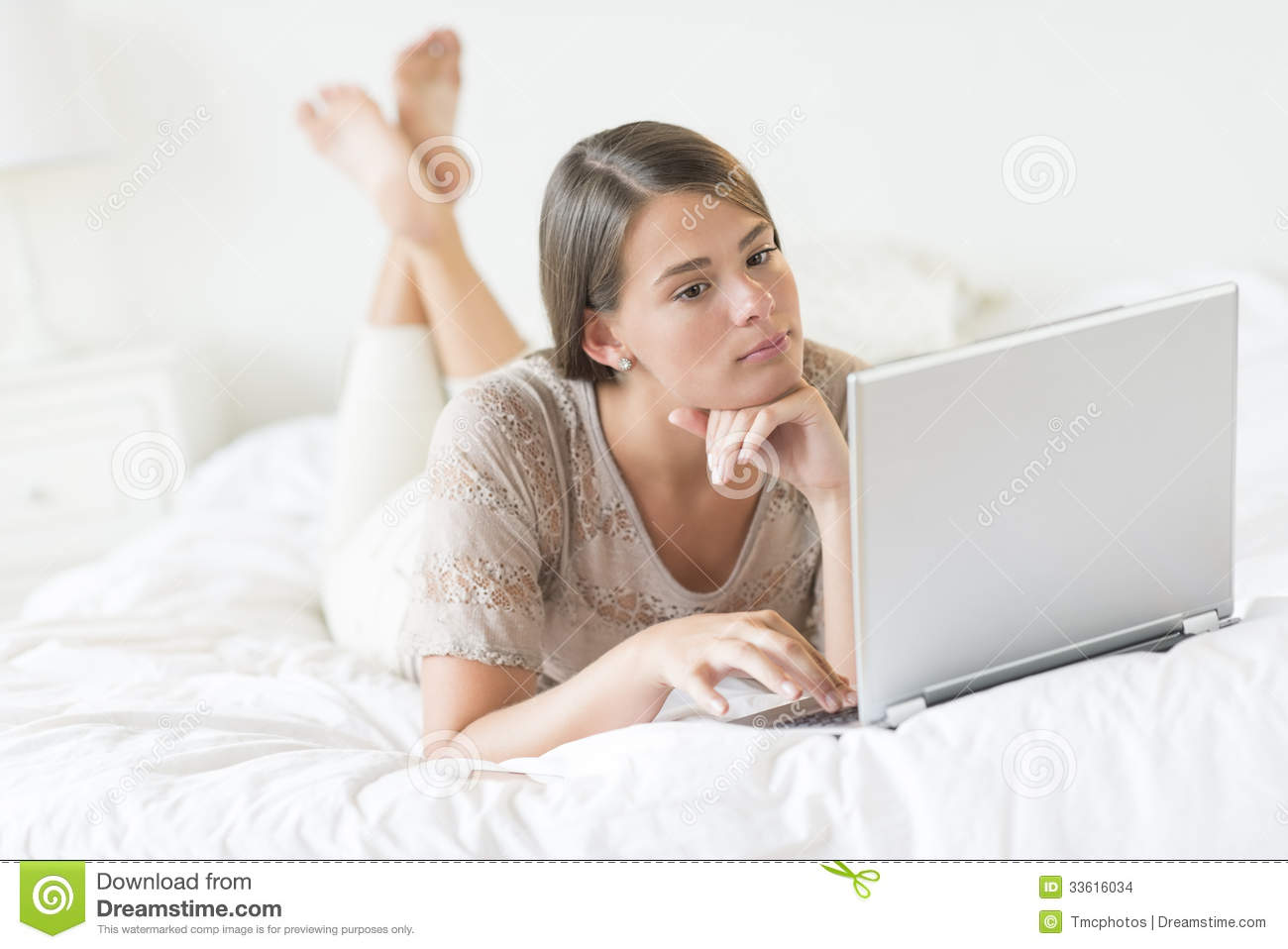 Teenage Girl Using Laptop In Bed Stock Photo Image Of