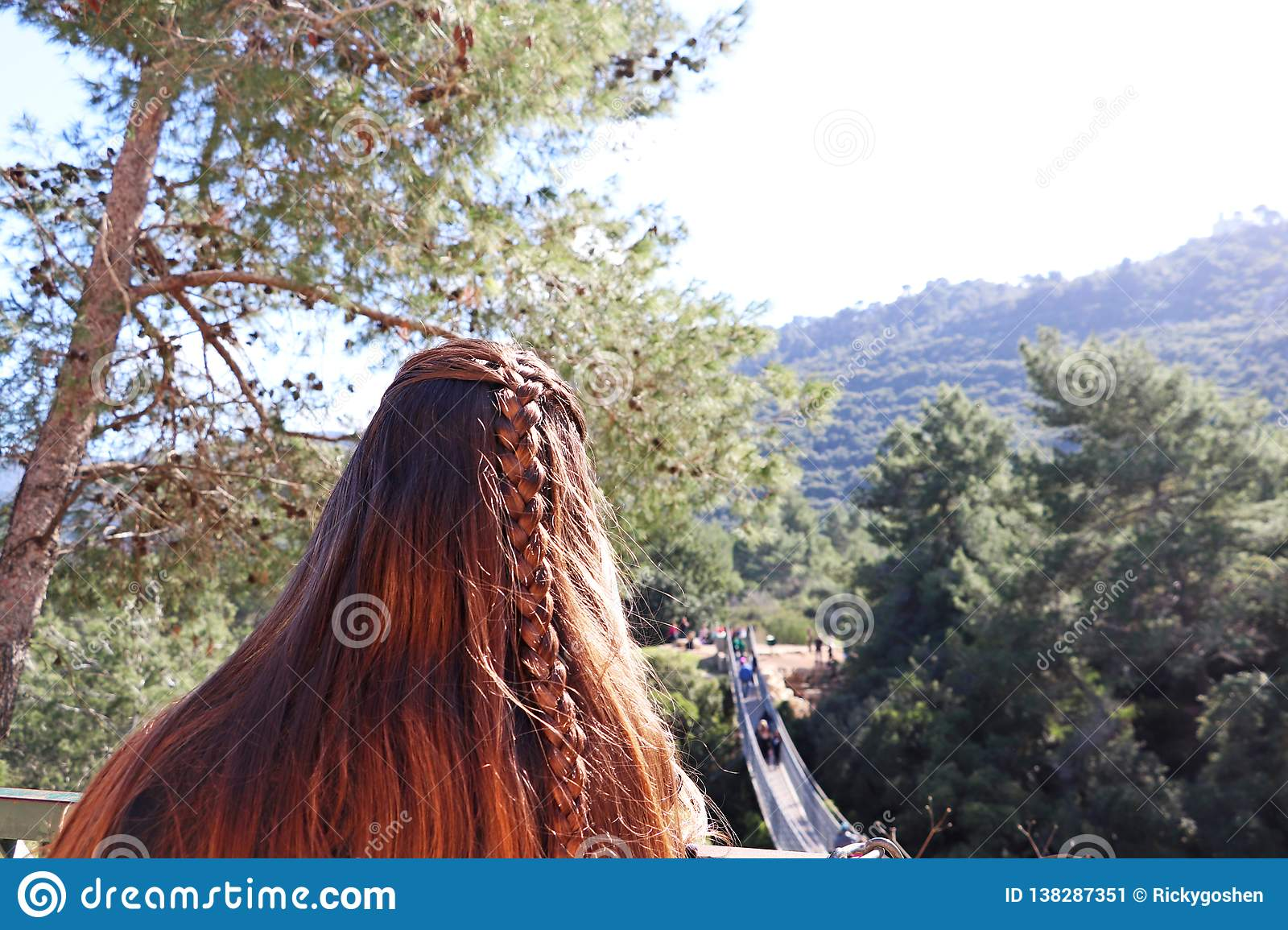 A beautiful teenage girl watching the landscape