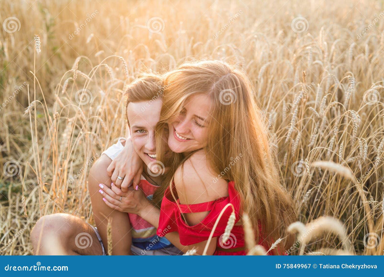 Teenage Girlfriend And Boyfriend Having Fun Outdoors Kissing