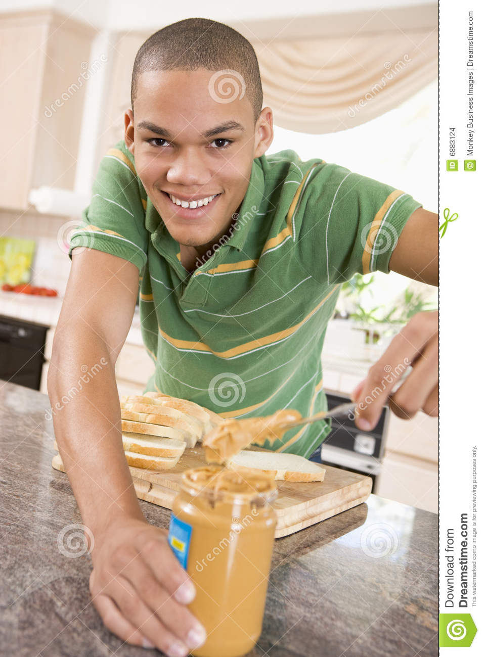 Teenage Male Making Peanut Butter Sandwich