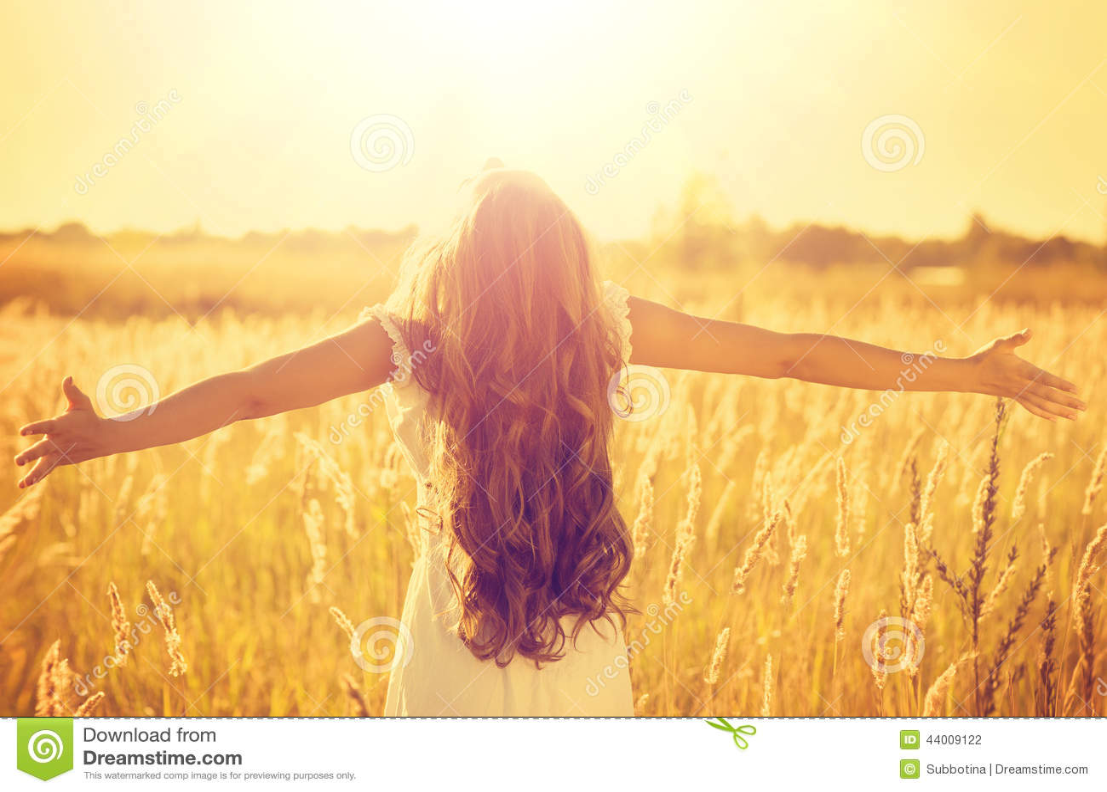 Teenage model girl in white dress enjoying nature