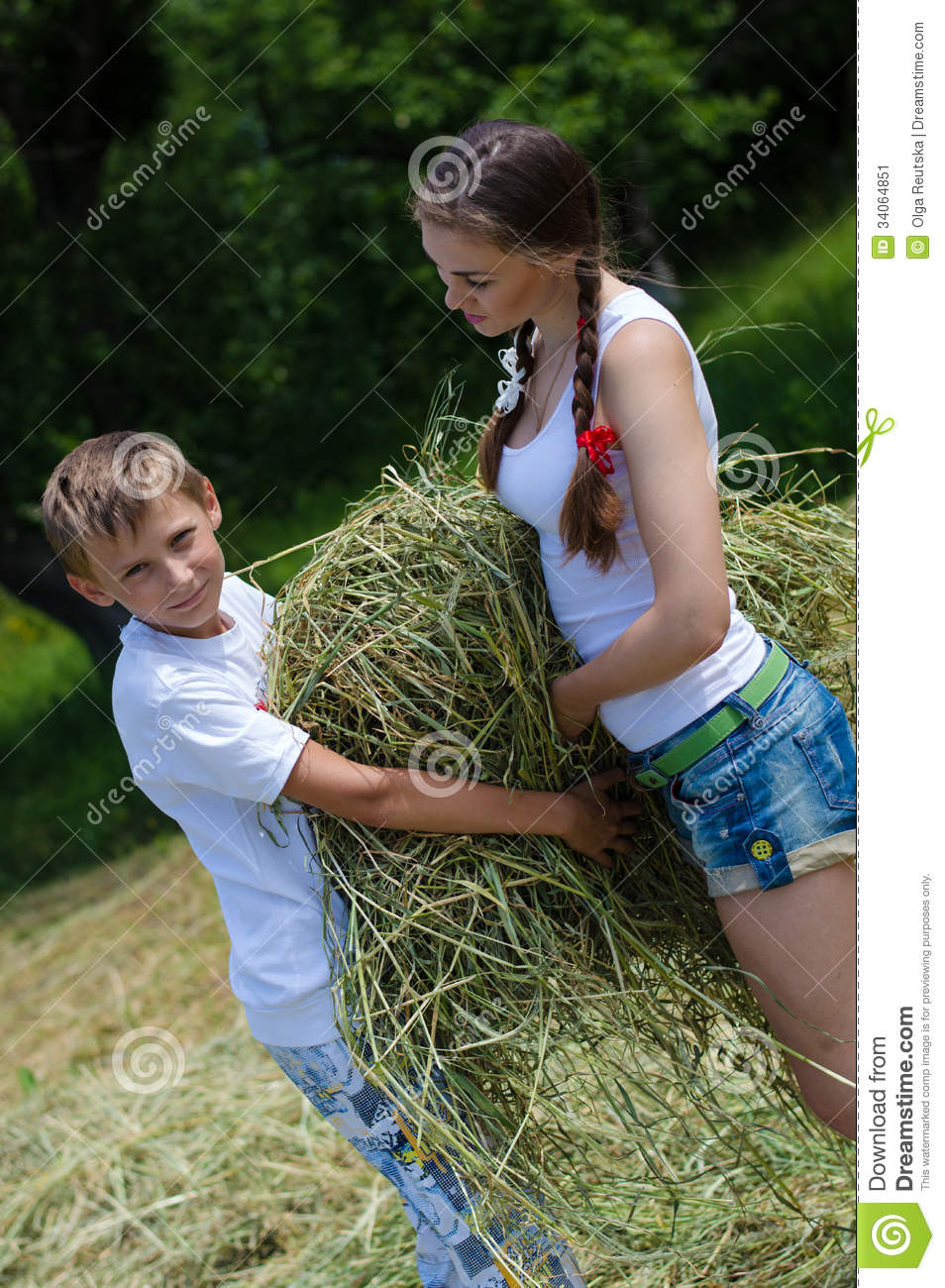 Teenage Sister And Little Brother Holding Velour Grass Or
