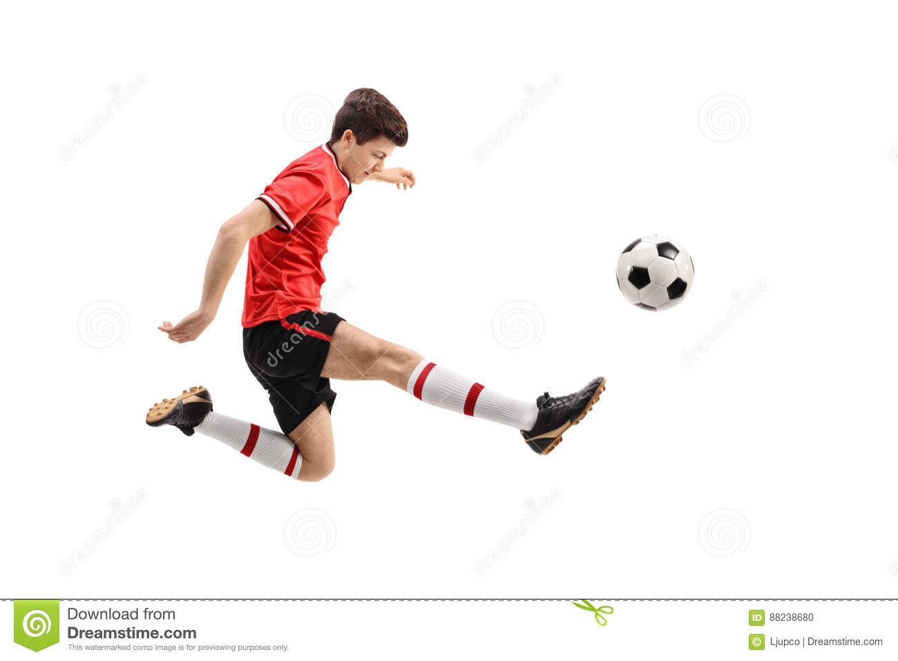 38737b938 Teenage soccer player kicking a football isolated on white background