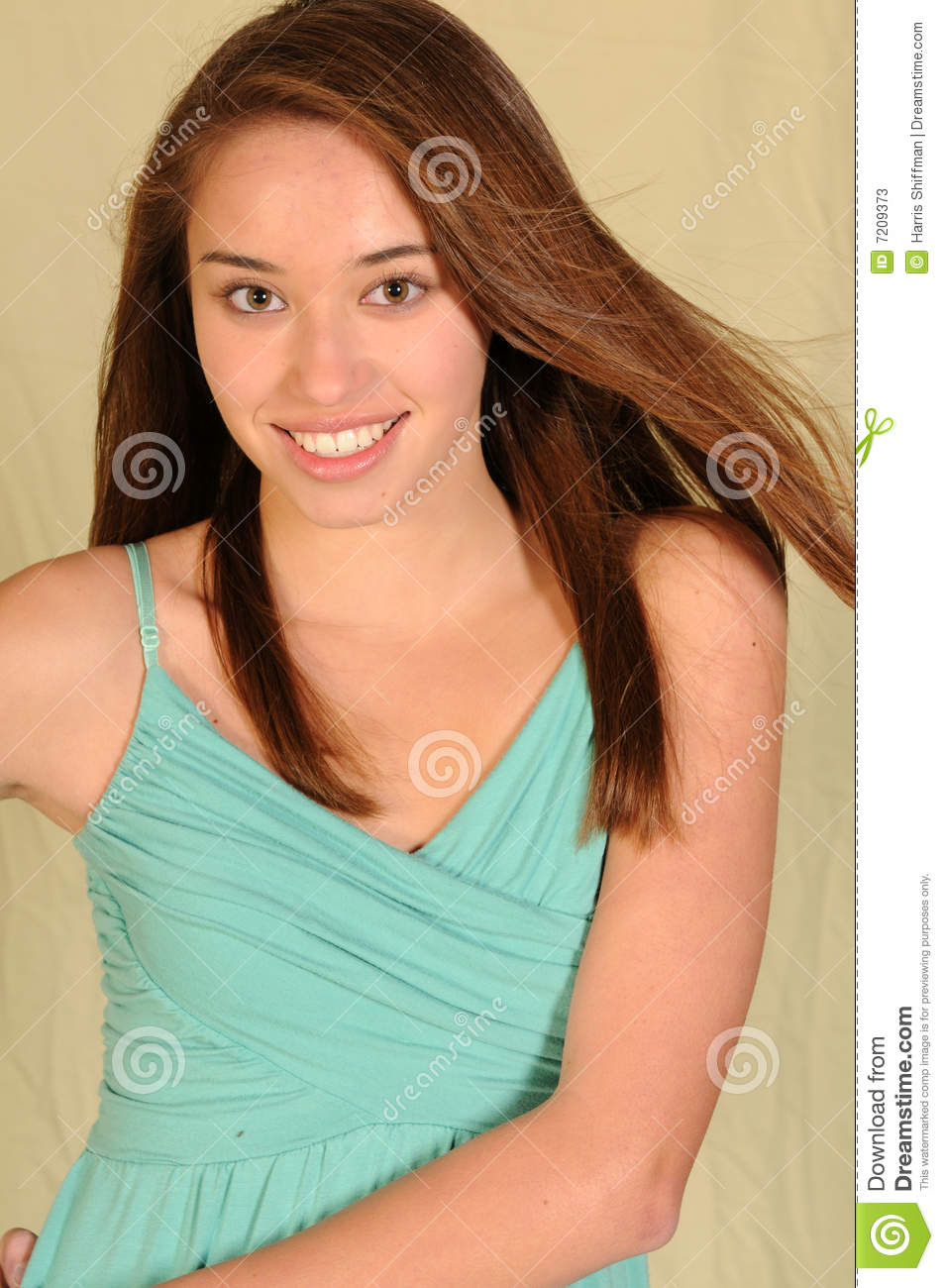Pretty young teenage girl with long brown hair