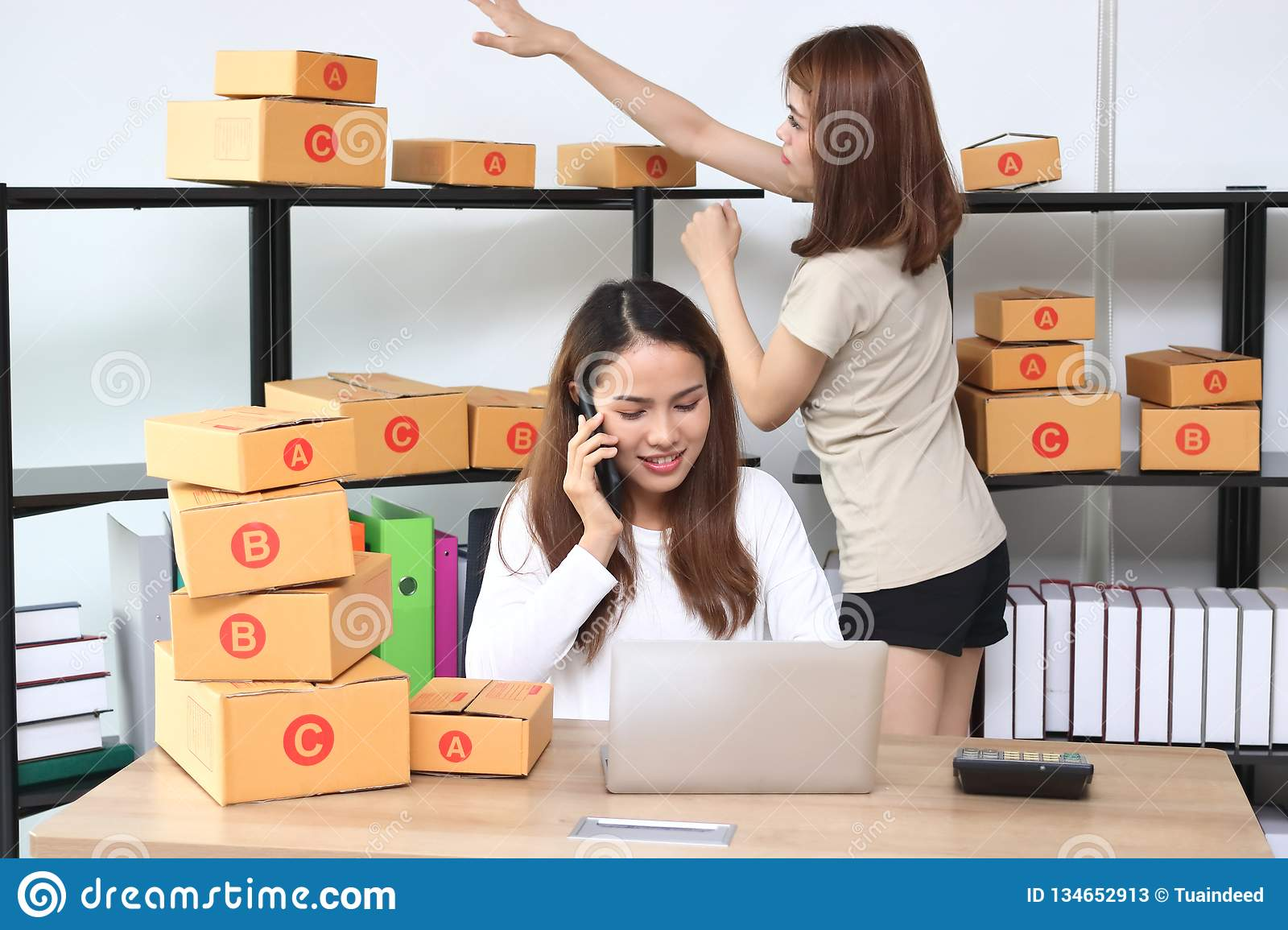 Teenager Asian entrepreneur owner working together at workplace at home. Start up small business