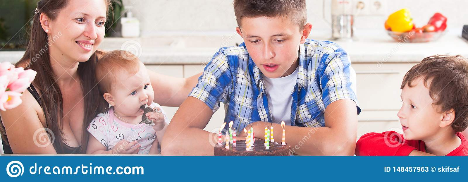 Teenager blows out the candles on a birthday cake